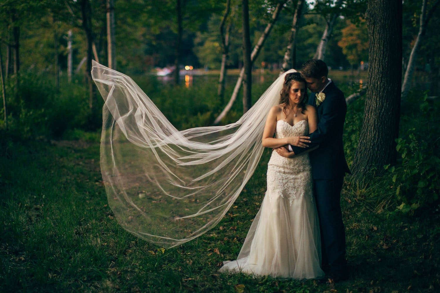 couple hugging with veil flowing in wind