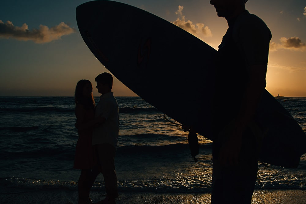 oahu surf couple silhouette