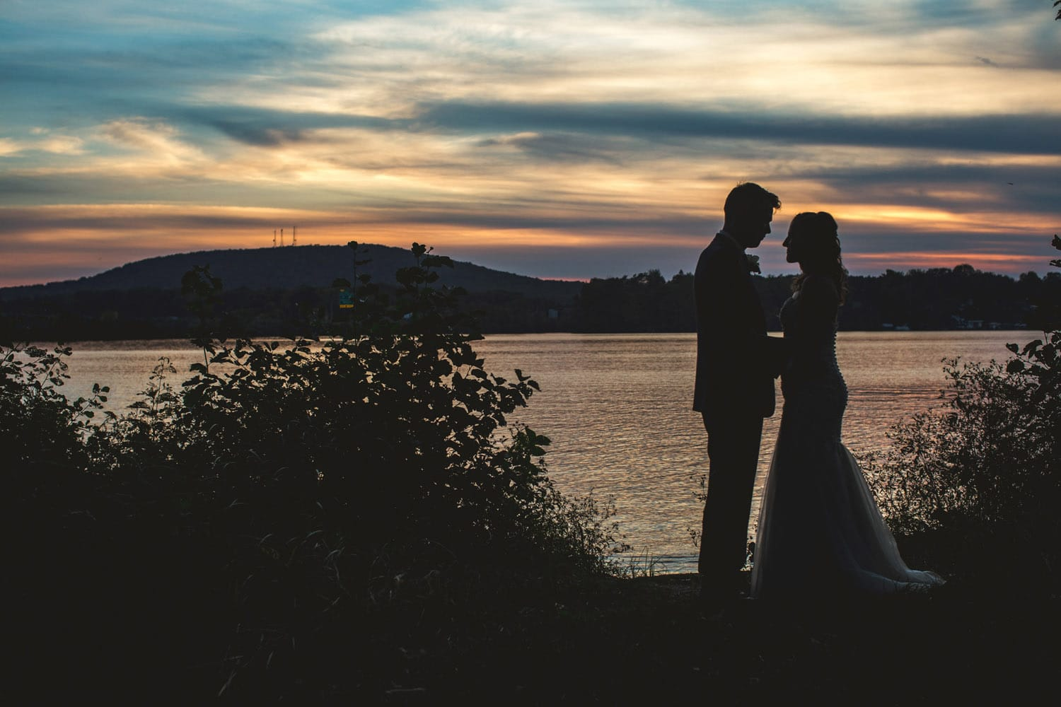 bride and groom on lakefront